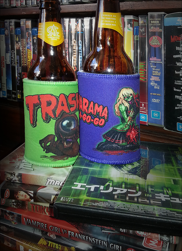 Purple Trasharama agogo stubbie holder sitting atop the japanese release of home grown queensland scifi-horror film the Dark lurking aka Alien in cube